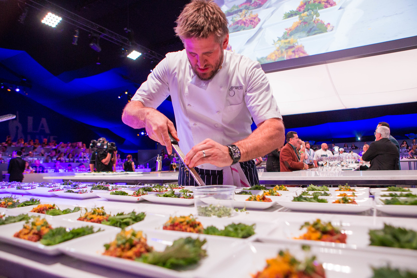 Chef plating food during All Star Chef Classic Event