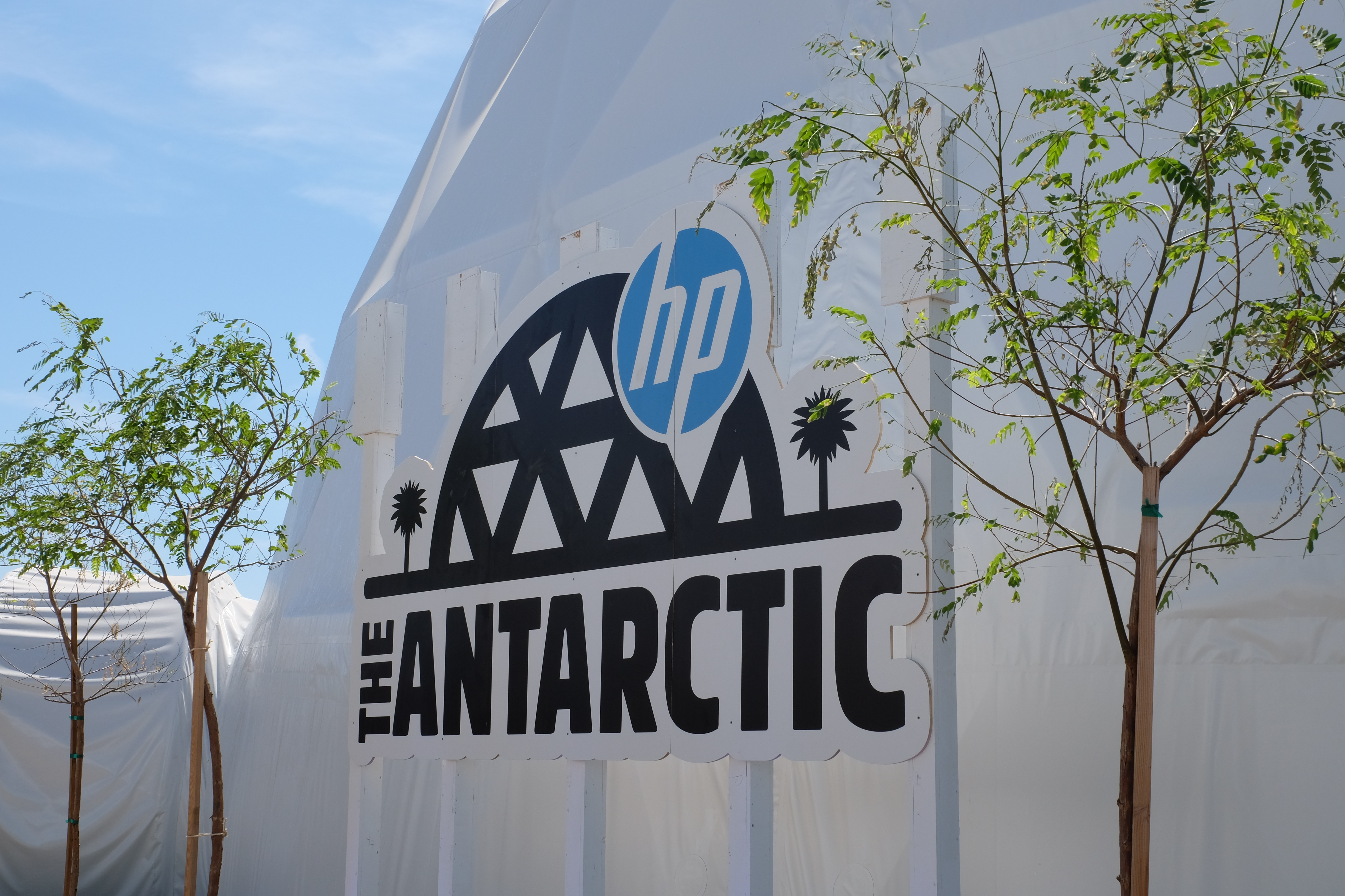 "Signage outside a tent that says ""The Antarctic"" with the HP logo"