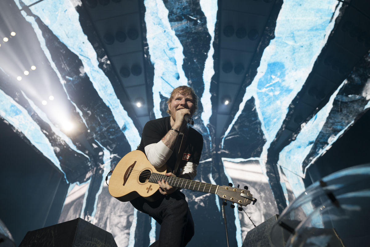 image of ed sheeran on stage singing