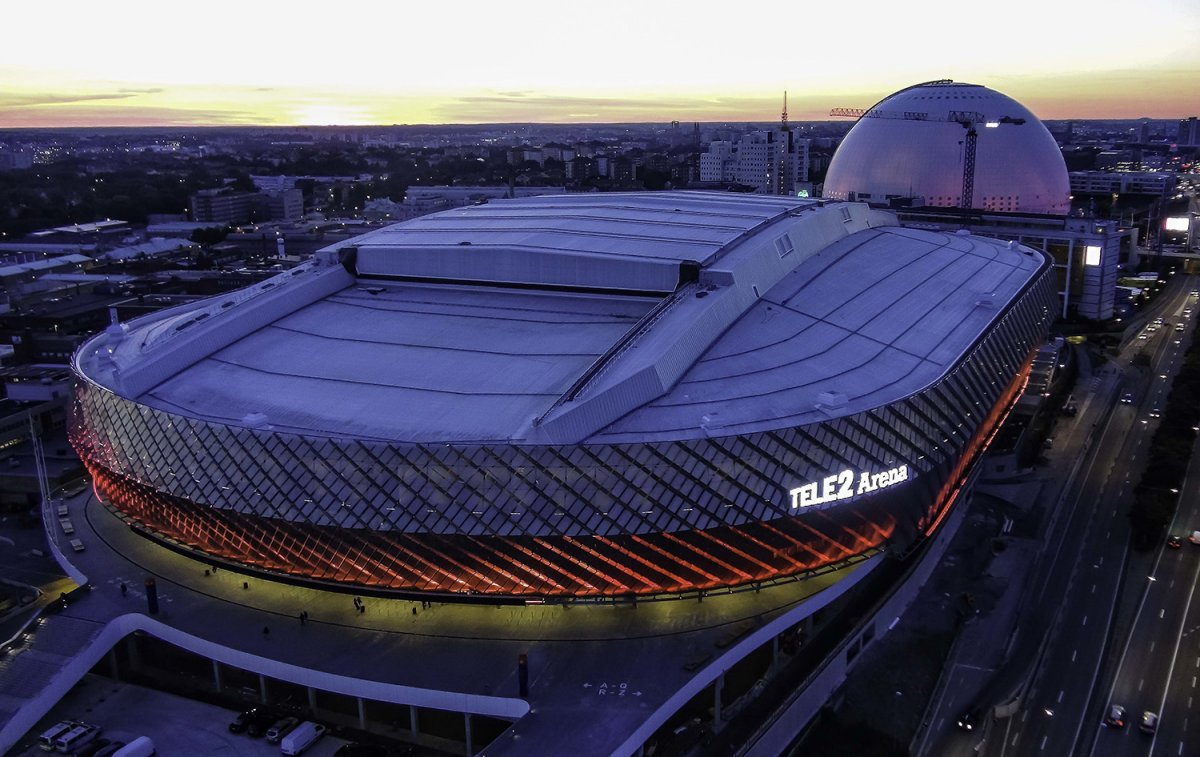 Overhead image of the Tele2 Arena at dusk with the lights on