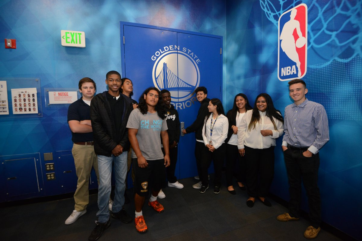 A group of young students outside the Golden State Warriors locker room