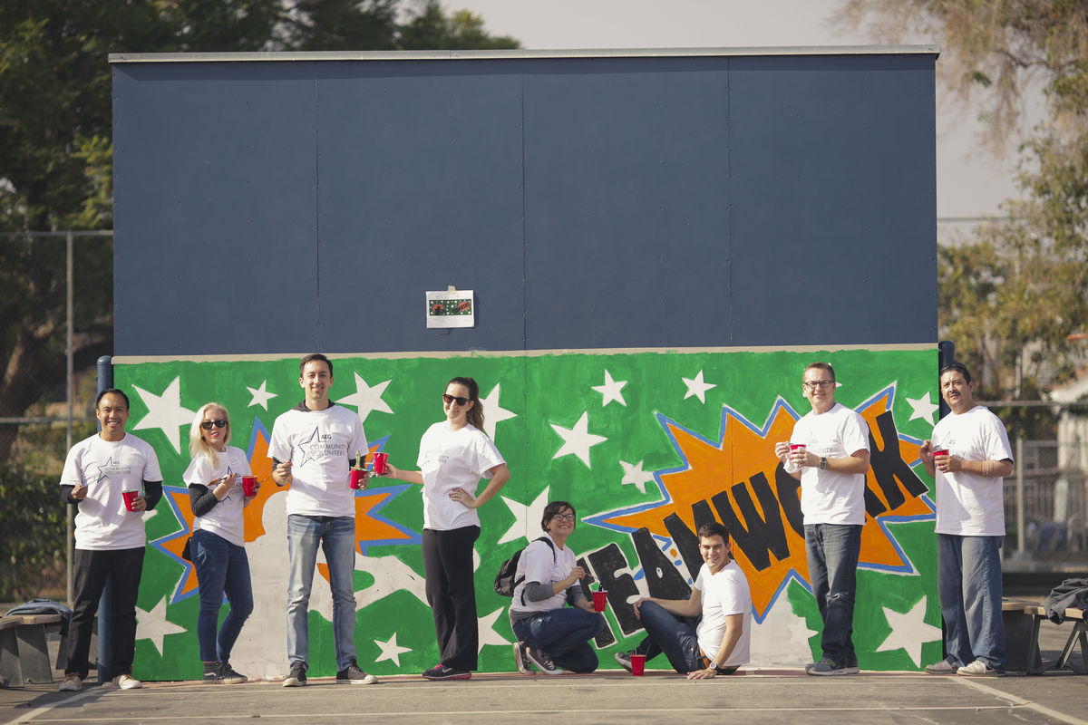 employees painting a mural