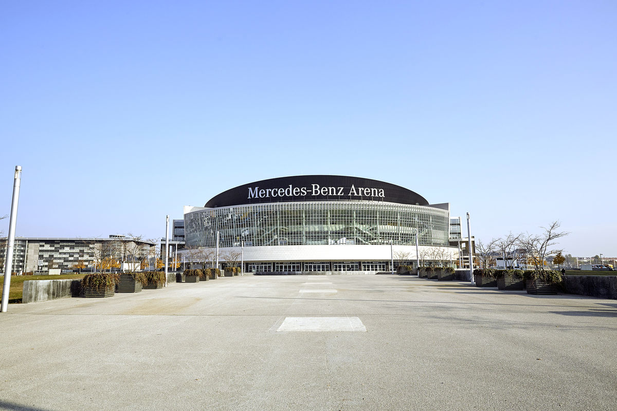 Exterior Image of Mercedes-Benz Arena and district during the day
