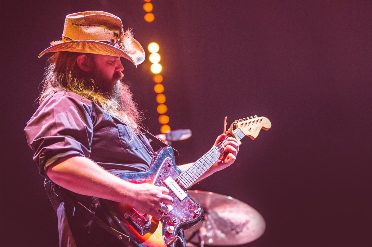 Close up image of Chris Stapleton playing the guitar at Country to Country