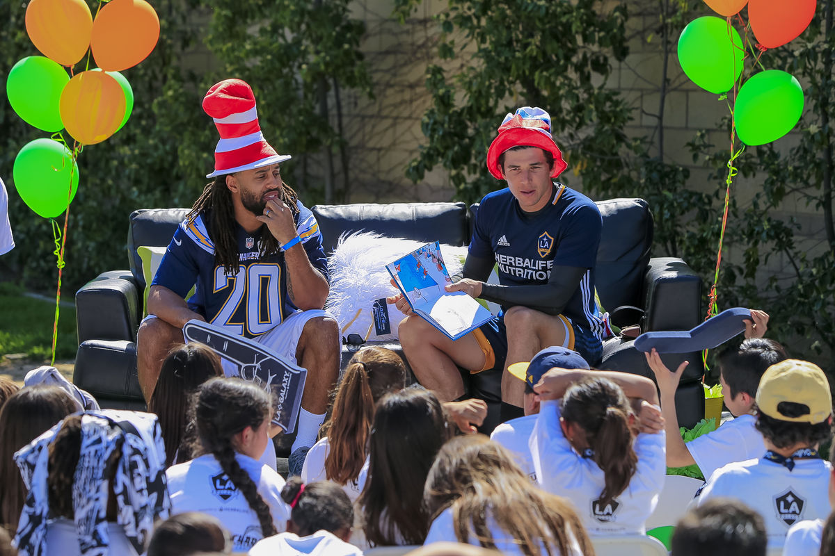 LA Galaxy goalie Brian Rowe and LA Chargers safety Dwight Lowery read to students during Read Across America Day at StubHub Center.