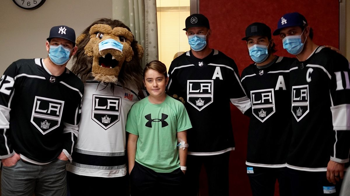 AEG's LA Kings players (from left to right) Jonathan Quick, Jeff Carter, Drew Doughty and Anze Kopitar meet with a patient during the team's annual team visit to Children's Hospital Los Angeles on January 16, 2018.