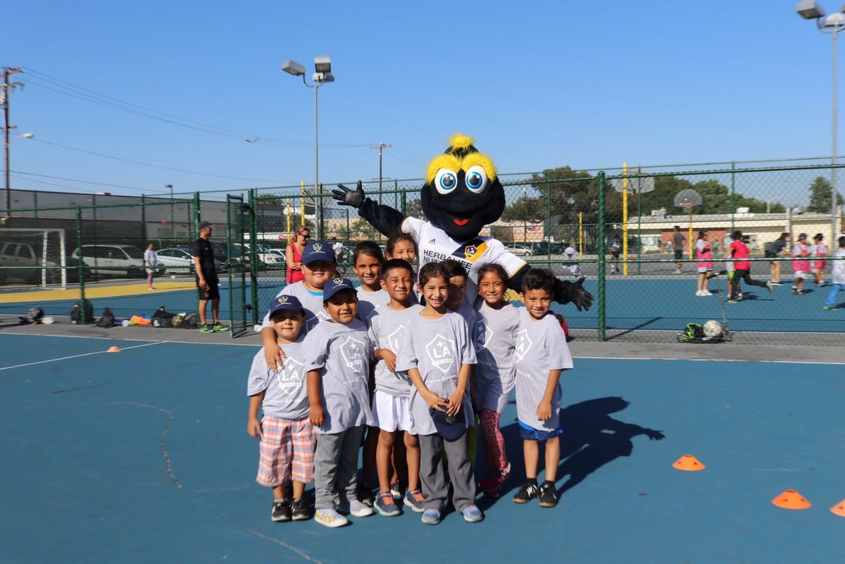AEG's LA Galaxy mascot Cozmo poses with children from the Los Angeles community during a free soccer clinic in conjunction with the Galaxy's Community Clinic Series. The LA Galaxy will host an additional free soccer clinic on Saturday, Aug. 26.