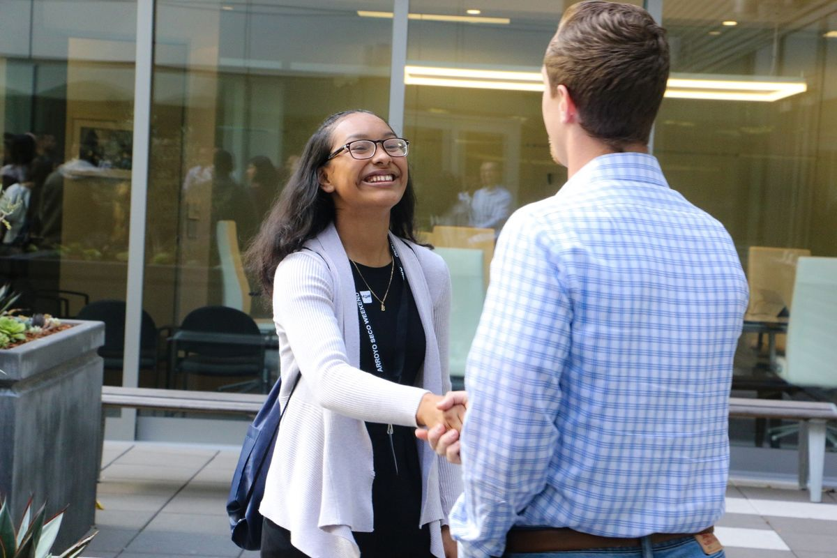 John Muir High School junior, Brenda Lopez shakes hands with her staff mentor for AEG's Arroyo Seco Weekend Job Shadow Day at AEG's global headquarters in downtown Los Angeles on April 26, 2017.