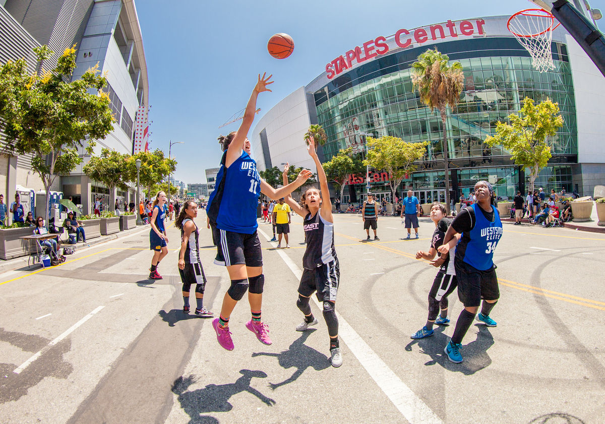 Three-on-three basketball teams compete on courts in front of STAPLES Center in downtown Los Angeles during the Nike Basketball 3ON3 Tournament presented by 24 Hour Fitness at L.A. LIVE.