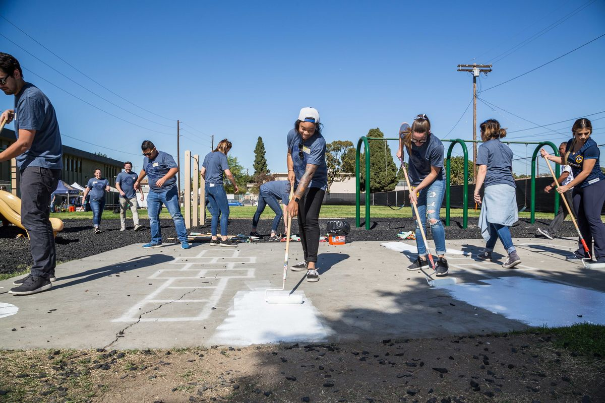 "LA Galaxy staff team up with Playworks Southern California to kick off ""Galaxy Giving"" by beautifying Community Preparatory Academy in Carson, Calif. on February 7, 2018."