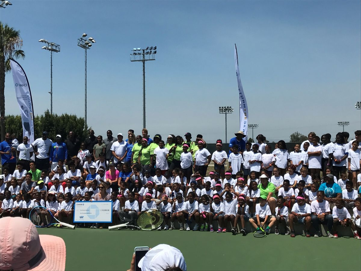 Participants and instructors from the Fourth Annual Chase Return the Serve Fun Day gather for a group photo at StubHub Center in Carson, Calif.