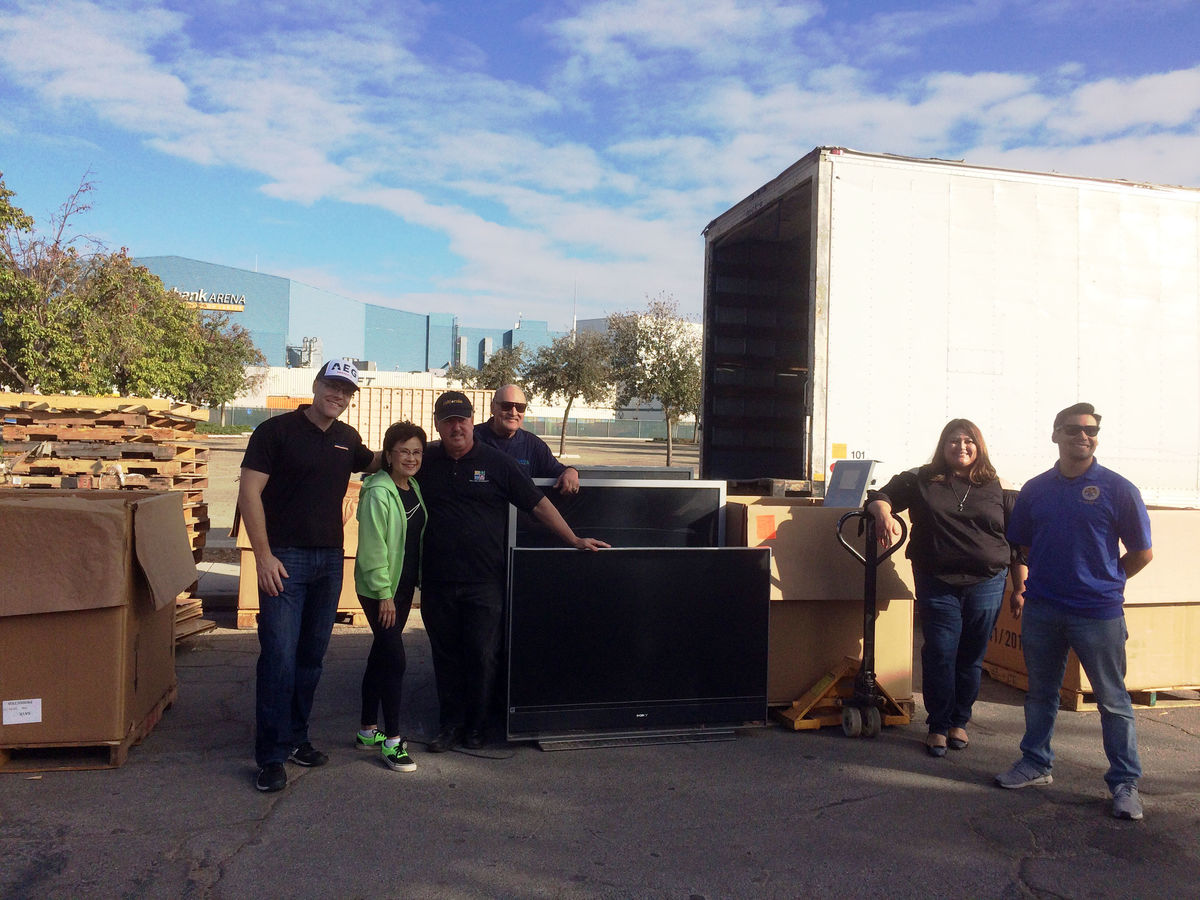 AEG's Rabobank Arena employees and Bakersfield Mayor Karen Goh (second from left) load recycled e-waste items into trucks at the 5th Annual Bakersfield Recycles Day on November 4, 2017.