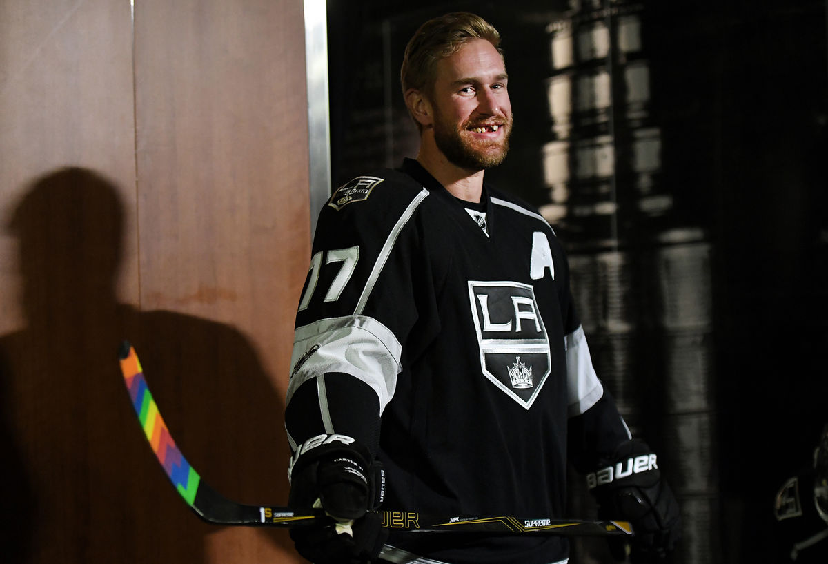 LA Kings all-star and assistant captain Jeff Carter heads to the ice before warm-ups with rainbow stick tape during LA Kings Pride Night.