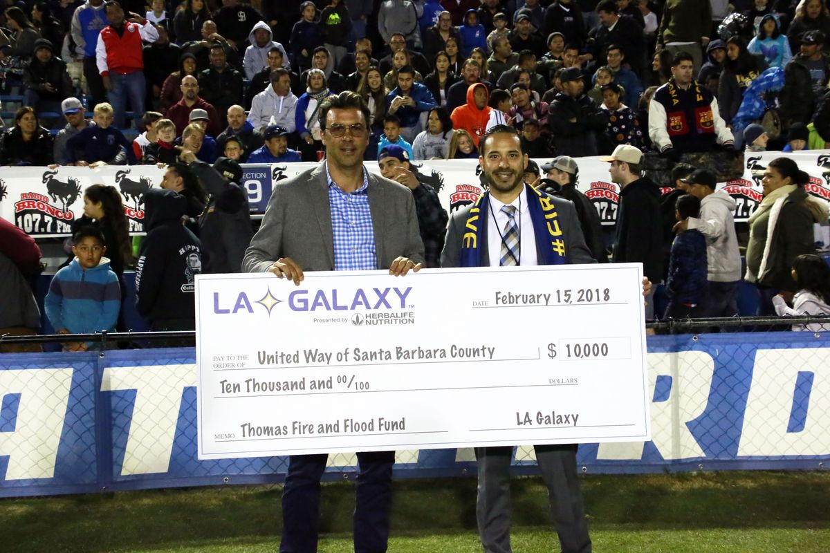 LA Galaxy Technical Director Jovan Kirovski presents a check to United Way Santa Barbara in support of the Thomas Fire & Flood Fund.