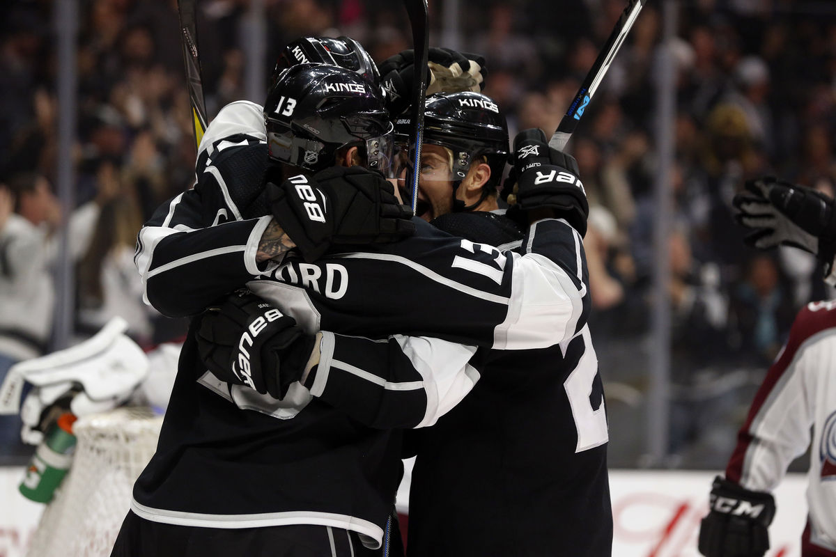 LA Kings players embrace after scoring a goal during a game at STAPLES Center.