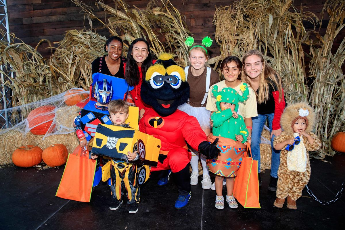 LA Galaxy Mascot Cozmo (disguised as a superhero) greets guests at the 12th Annual Treats-n-Suites Halloween Bash at StubHub Center in Carson, Calif. on October 26, 2018.