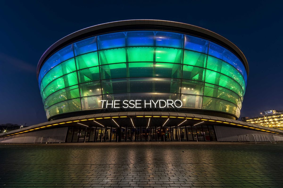 The SSE Hydro Arena in Glasgow illuminated at night.