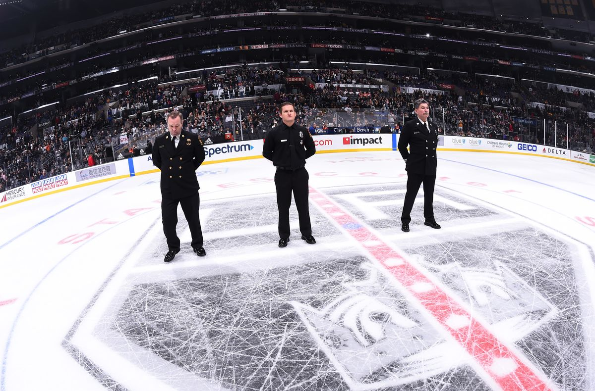 Chief Deputy Fred Mathis – the Commander of LA City Fire Department's Administrative Operations Bureau, Firefighter/Paramedic Michael Mandahl – Medal of Valor Recipient and LA City Fire Department Captain Ted Kalnas are honored on the ice at STAPLES Center during the LA Kings game on Nov. 25, 2018.