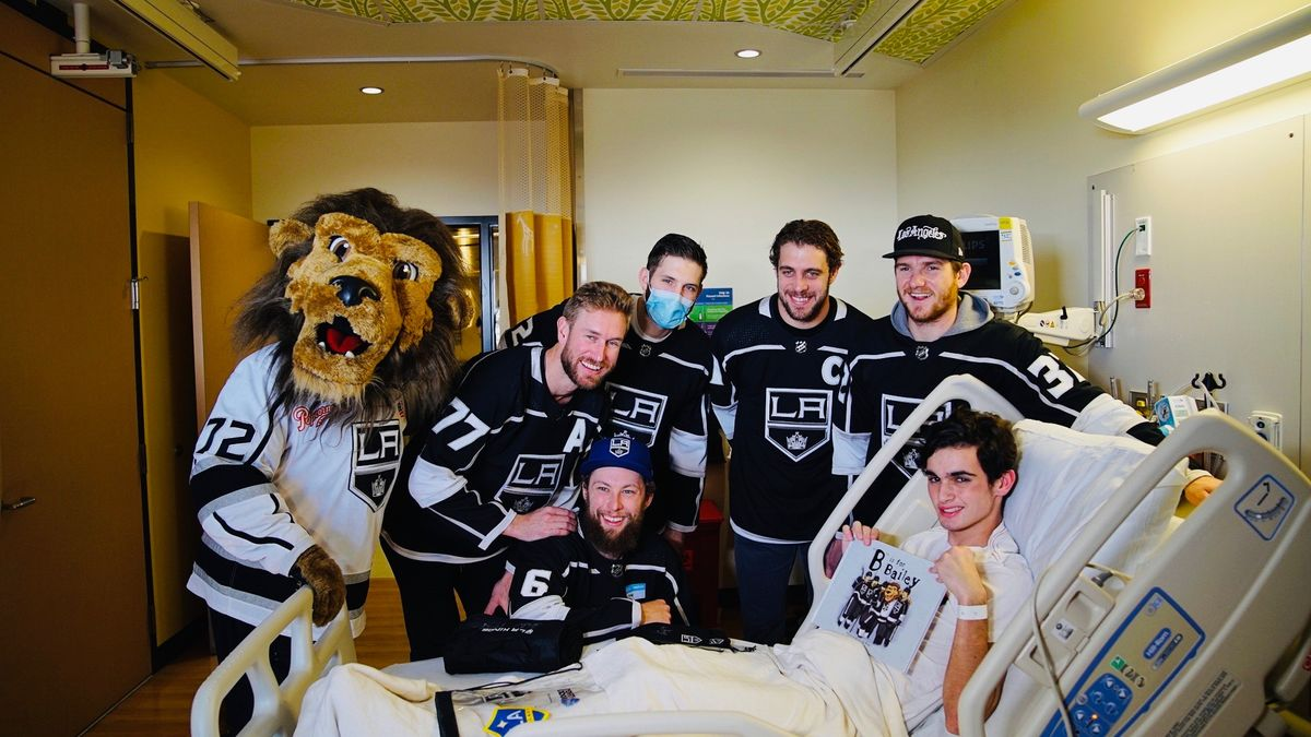 LA Kings players (from left to right) Jeff Carter, Jake Muzzin, Derek Forbort, Anze Kopitar and Jonathan Quick join Bailey in visiting patients during the annual LA Kings visit at Children's Hospital Los Angeles on January 9, 2019.