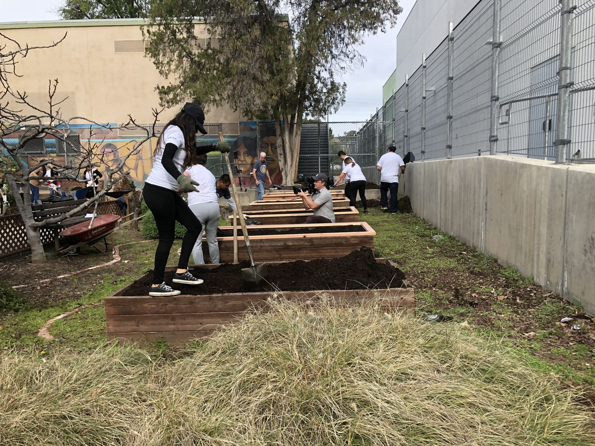 LA Kings employees install planter beds at Garvanza Elementary in Los Angeles.