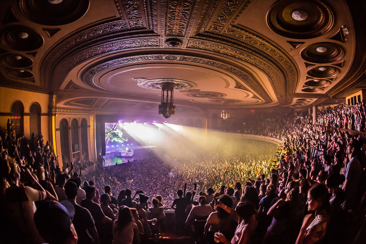 Fans in the balcony gaze onto the stage below during a concert at The Masonic Temple in Detroit