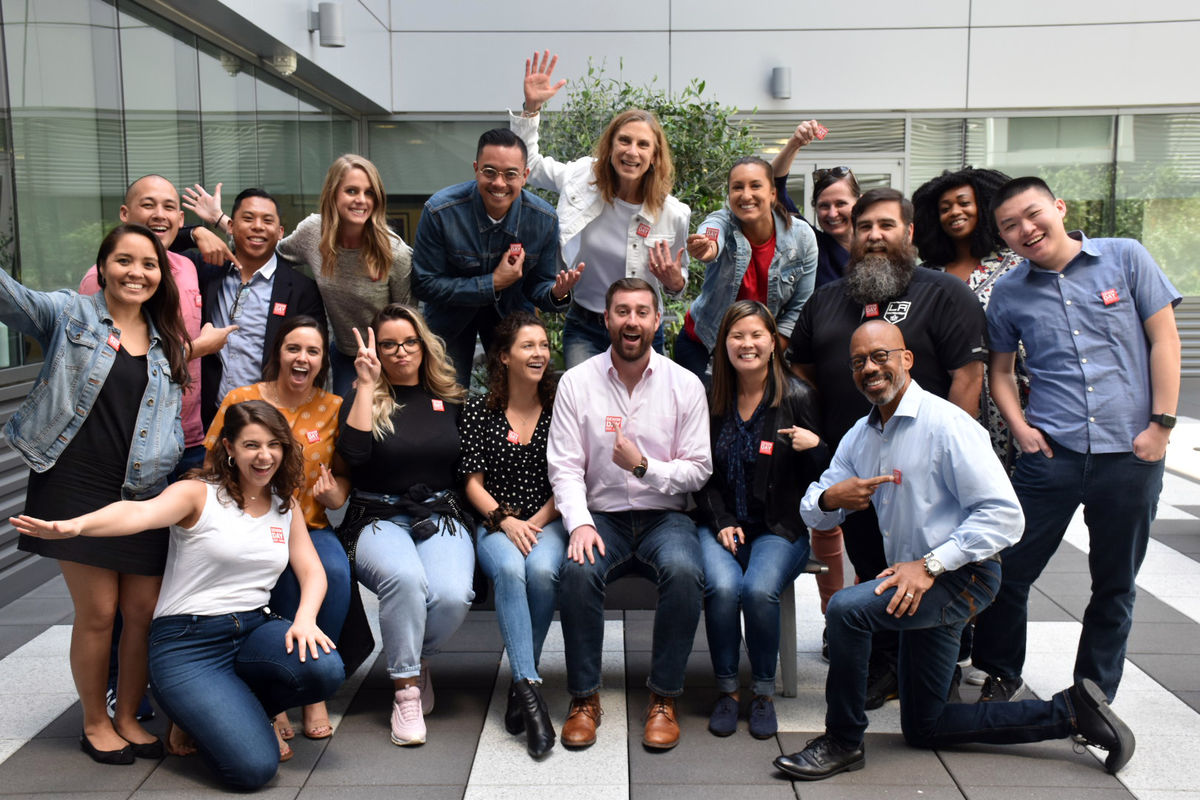 AEG employees wear denim and gather for a group photo for Denim Day, a campaign to raise awareness of sexual assault.