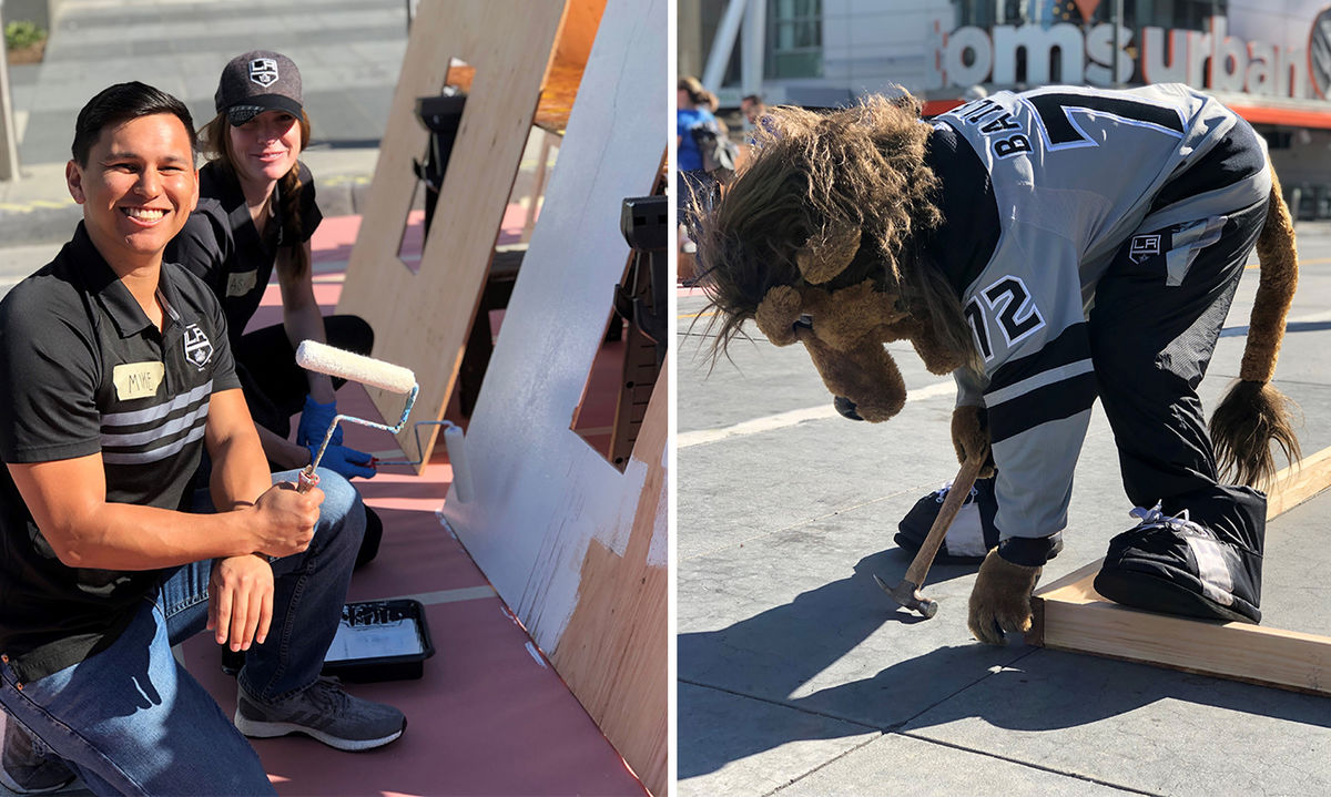 Two photos: The first of two employees smiling while painting a wooden plank and the second of LA Kings mascot Bailey hammering two pieces of wood together.