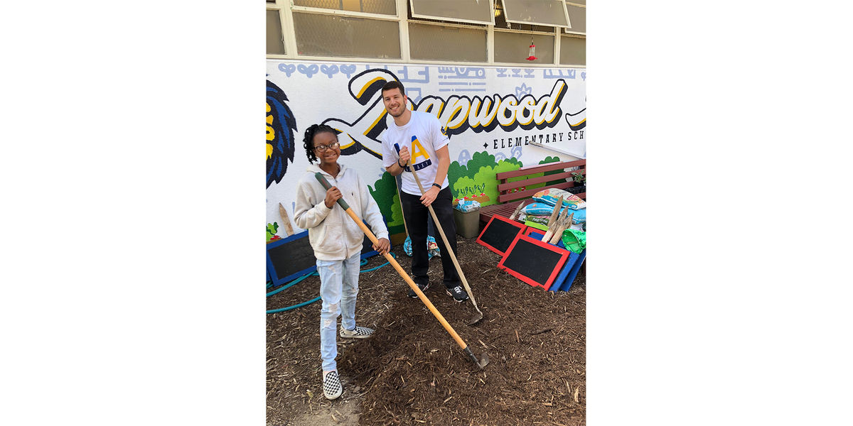 LA Galaxy Staff and a student from Leapwood Avenue Elementary work in the school's garden during an Earth Month event.