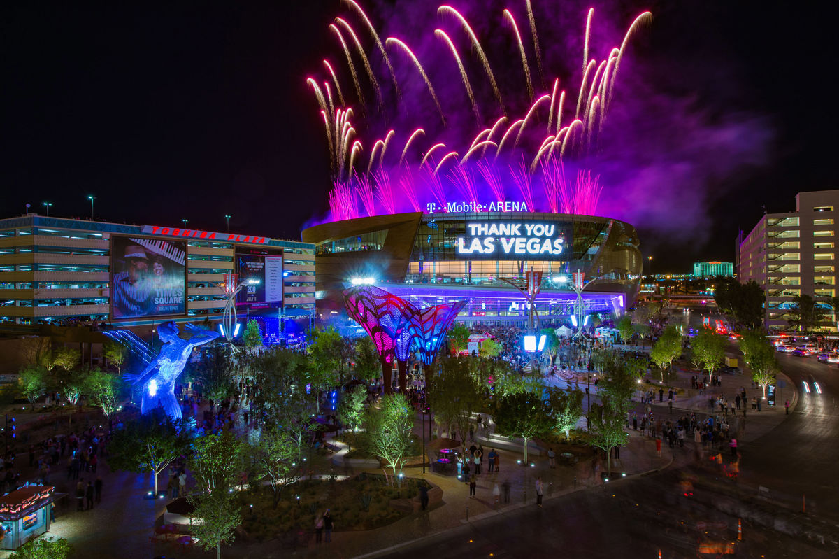 T-Mobile Arena in Las Vegas at night with fireworks above.