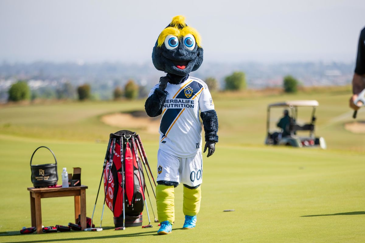 LA Galaxy mascot Cozmo walks the green with a golf bag during the LA Galaxy Golf Tournament.