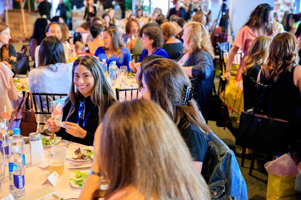 Female executives sit at tables and network and discuss issues and trends affecting women working in the entertainment industry during the Sixth Annual Women in Entertainment Luncheon.
