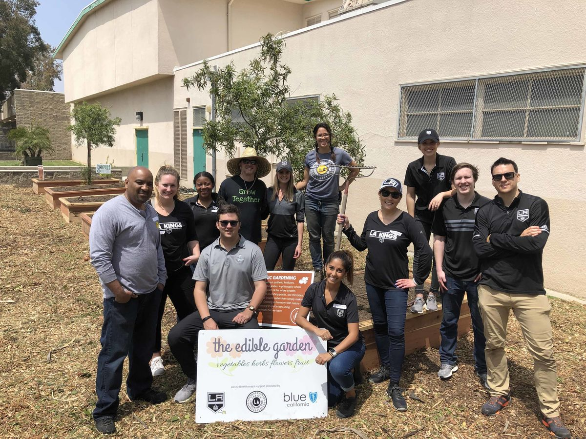 Member of the LA Kings staff pose for a photo following the completion of a garden build at an elementary school in Los Angeles.
