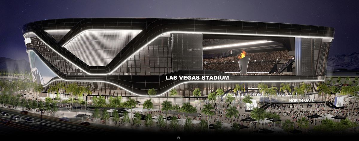 A rendering of the Las Vegas Stadium depicts the stadium at night illuminated by lights with trees surrounding the entrance.