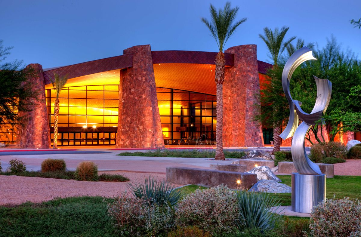 The Palm Springs Convention Center is illuminated at dusk