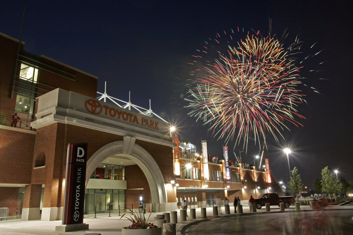 Exterior image of Toyota Park at night with fireworks behind it