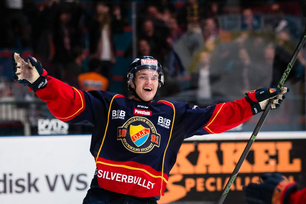 Djurgarden hockey player celebrating on the ice