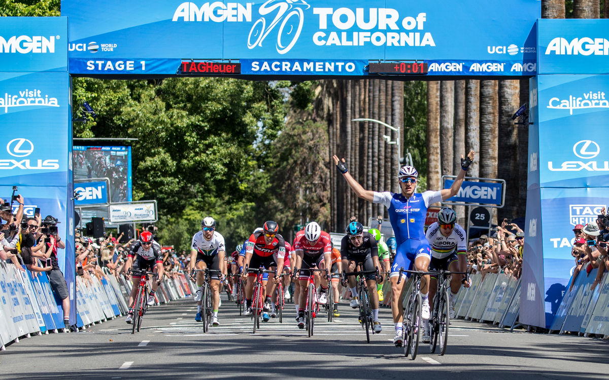 Racers cross the finish line for Stage 1 of Amgen Tour of California in Sacramento.