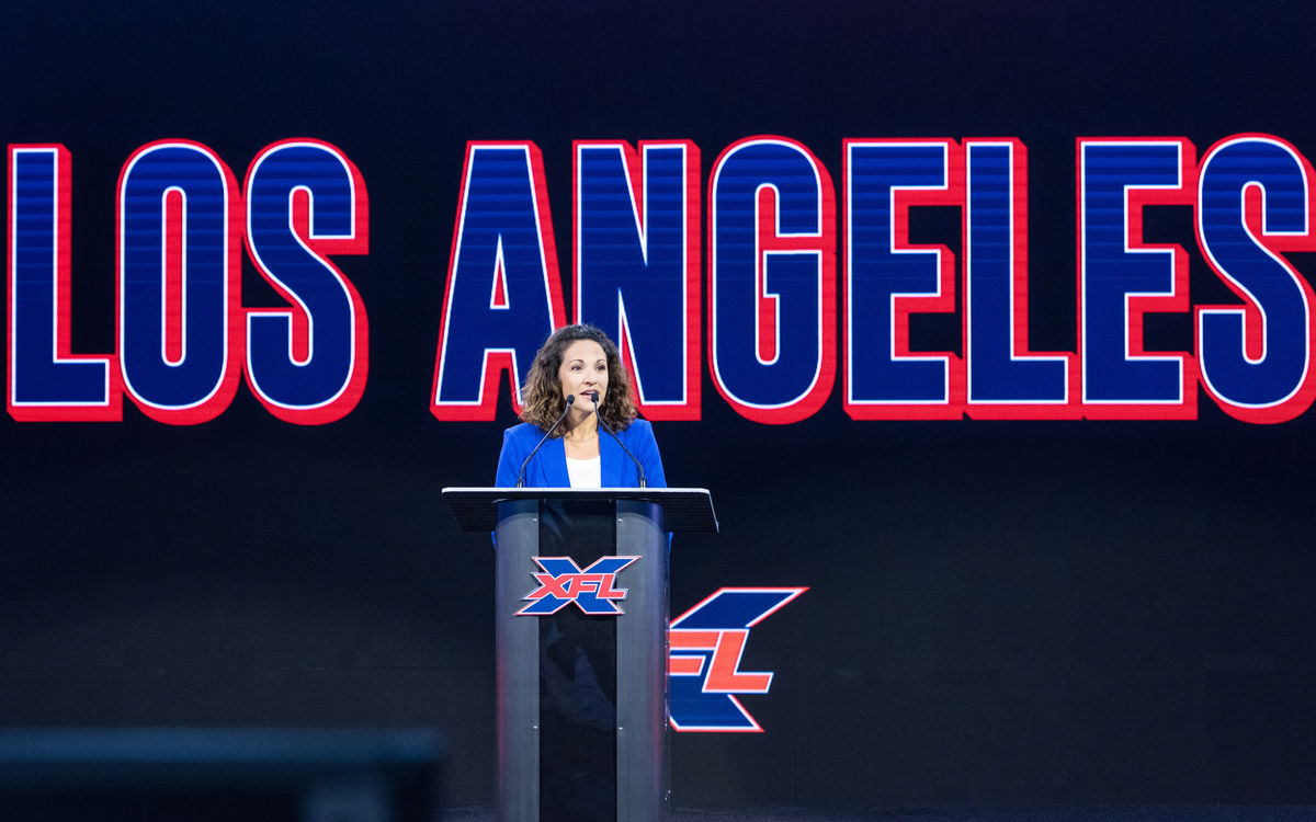 StubHub Center General Manager Katie Pandolfo addresses a group from the podium at a press conference for XFL.
