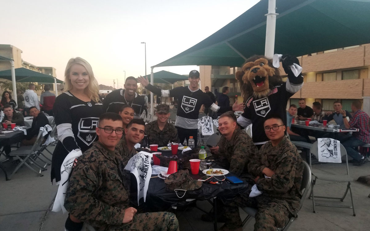 LA Kings Ice Crew and Kings mascot Bailey join marines for dinner as part of the LA Kings Watch Party at Twentynine Palms Marine Corps Air Ground Combat Center.