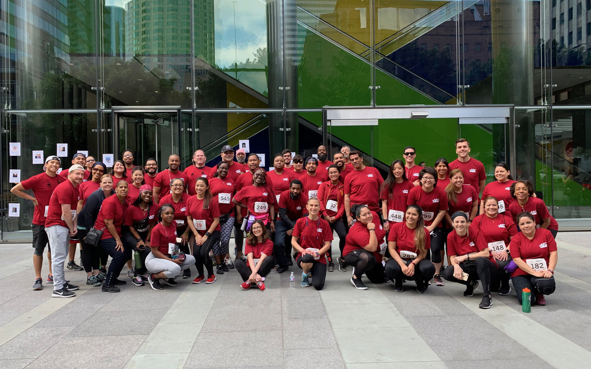AEG employees gather for a group photo following the Fight for Air Climb event in downtown Los Angeles.