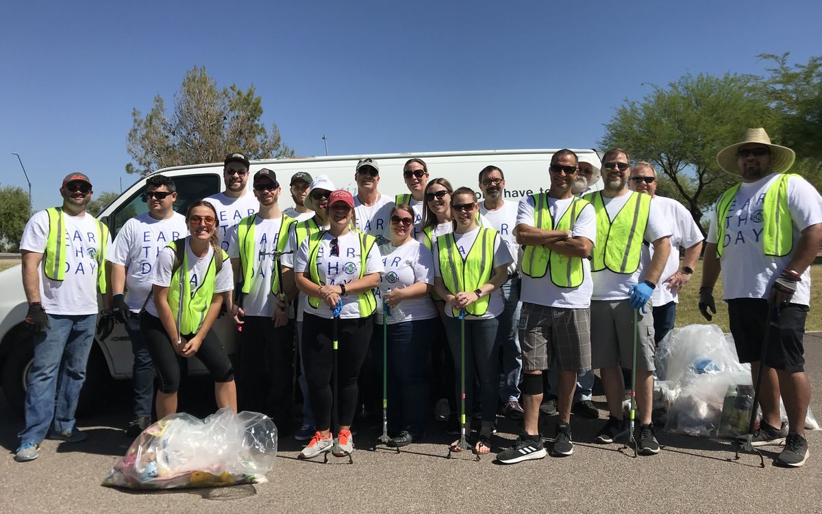 Gila River Arena employees gather for a group photo following picking up trash in two parks around the arena on Earth Day.