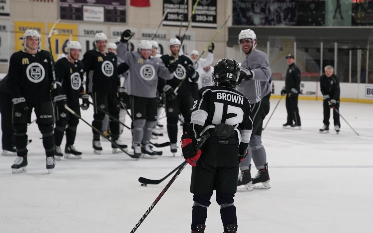 Twelve-year-old Jacob Brown skates out to the LA Kings team on the ice at Toyota Sports Park during a team practice as part of his Make-A-Wish to be a part of the team.