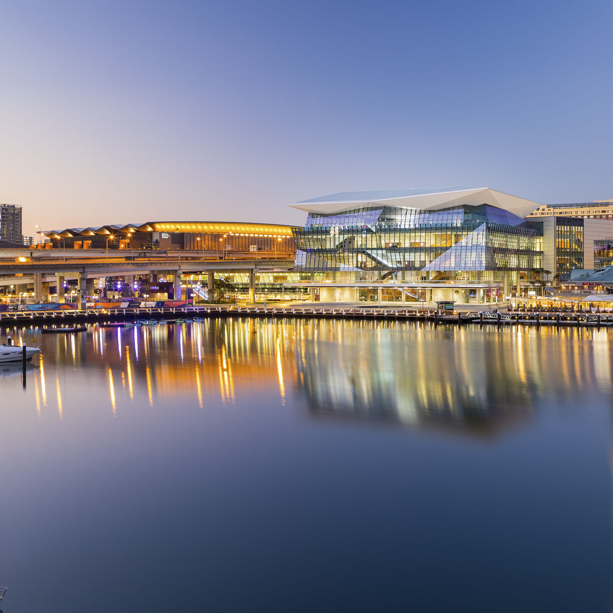 Exterior Image of International Convention Center Sydney at dusk on the water