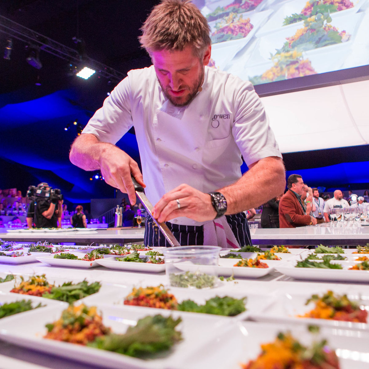 Chef prepping plates at the All-Star Chef Classic