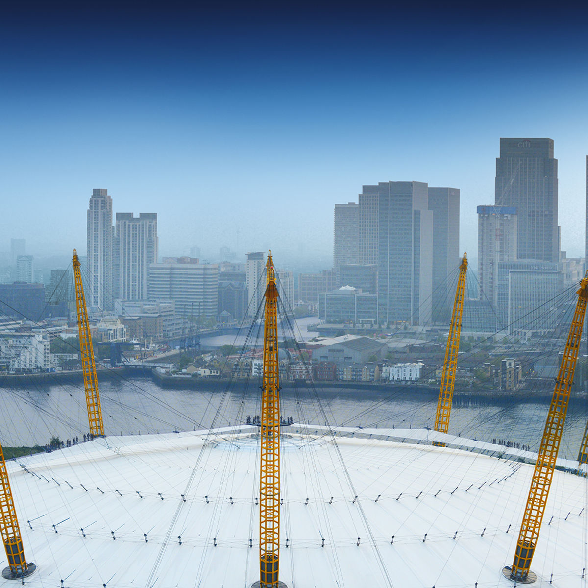 Aerial view above the O2 with city skyline