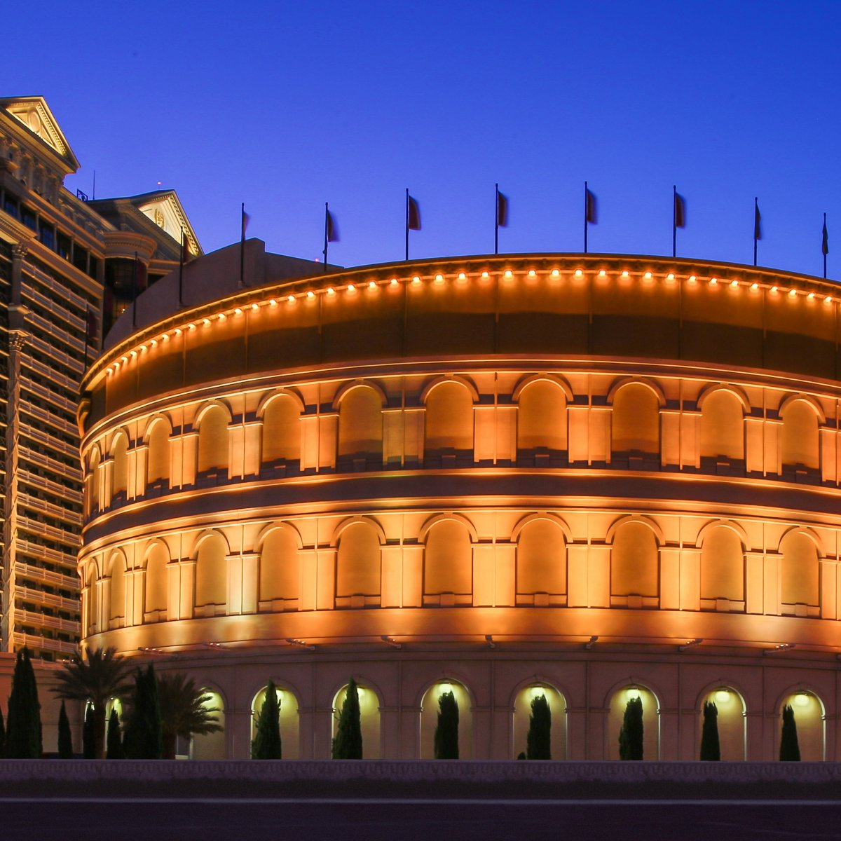 Exterior shot of the Colosseum at night