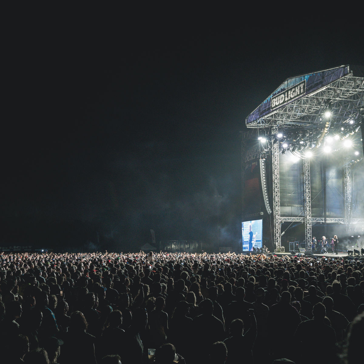 Image from the side of performers on stage at night
