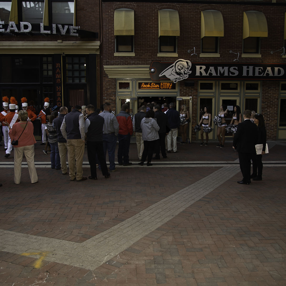 Exterior image of Ram's Head Live! With signage and people outside
