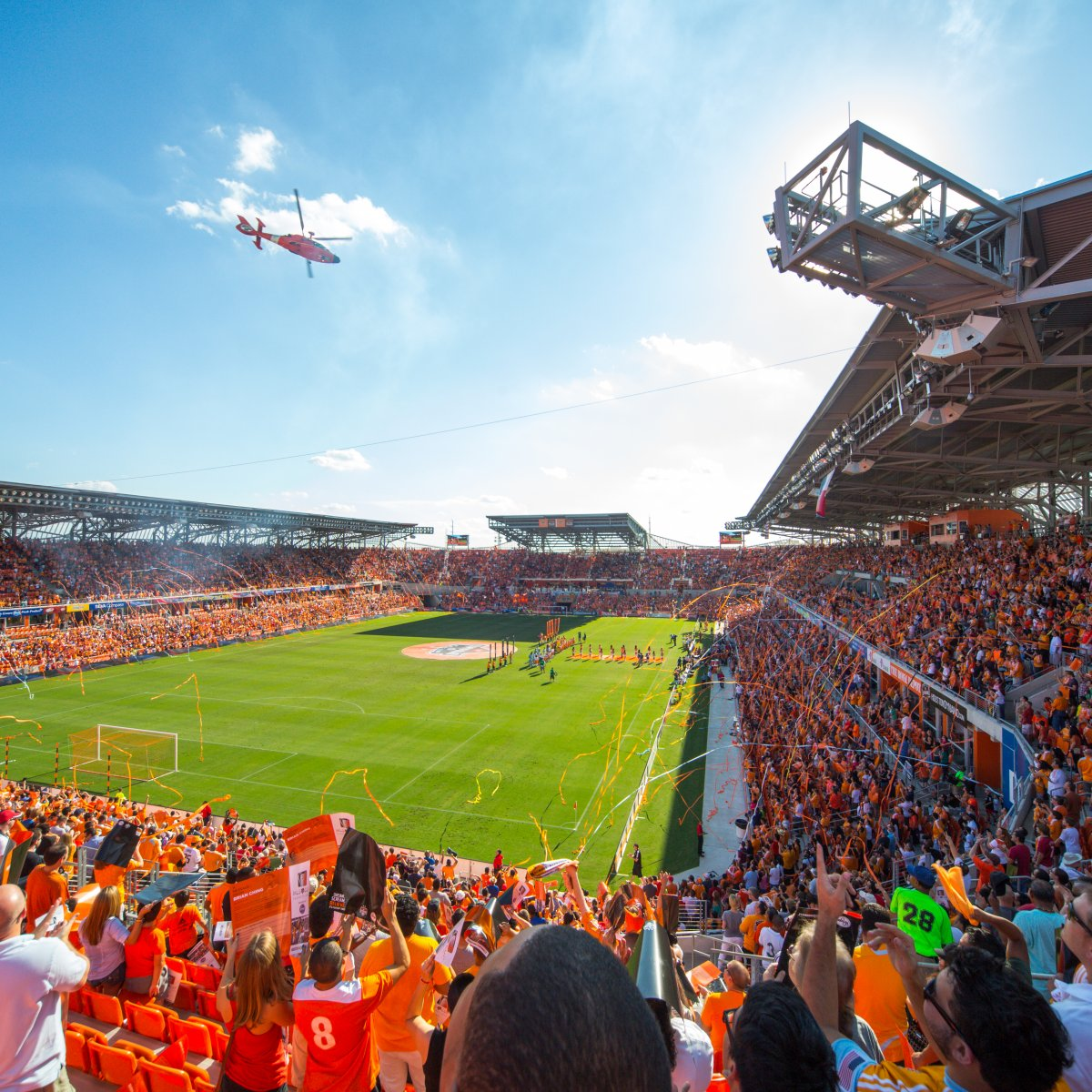 Interior image of BBVA Stadium during a soccer game with the crowd cheering