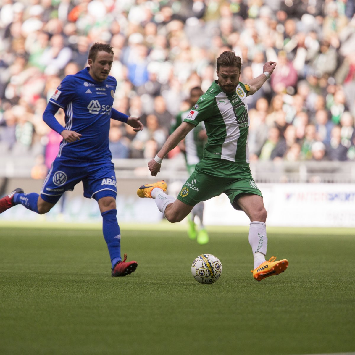 Hammarby soccer player about to kick the ball
